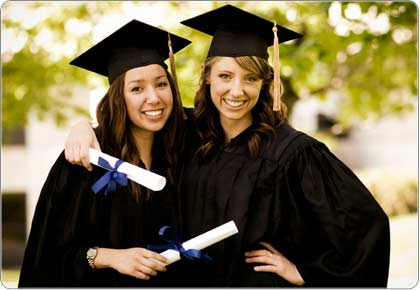 Two female graduates holding diplomas